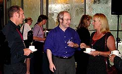 Jakob Nielsen mingles with attendees
