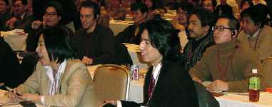 Attendees in Tokyo listening to the Main Event